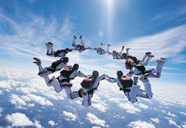 group-circle-sky-diving-above-clouds