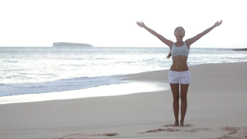woman-on-beach-sand-sea-live-simply